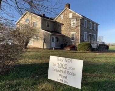 Anti-solar sign in yard