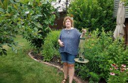 Cindi Fink with an empty birdfeeder.