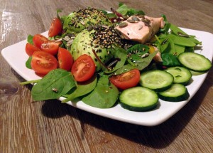 Cucumber, tomato, spinach, lambs lettuce, mange tout, avocado, furikake (sesame and seaweeds), pumpkin seeds, and finally steamed salmon, all drizzled with flaxseed oil... now that's what I call breakfast!
