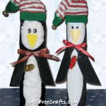 pair of paper towel roll penguins