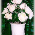 pot of blooming silk roses