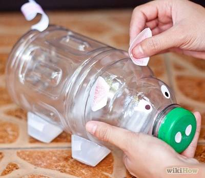 decorating a bottle piggy bank