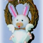 pompom Easter bunny hanging on a wreath