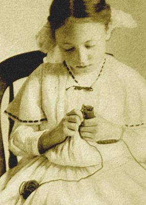 girl spool knitting in early 1900s