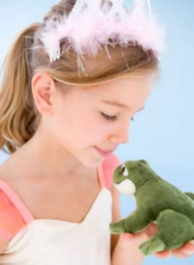 girl dressed as princess with toy frog