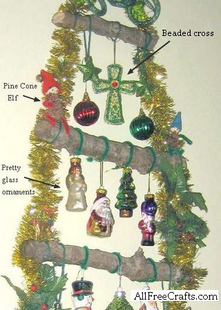 close of ornaments hanging on wall tree