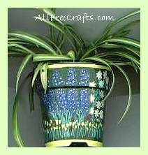 plastic pot decorated with paint markers