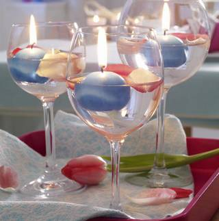 floating candles in wine glasses