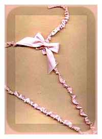 ribbon covered clothes hanger