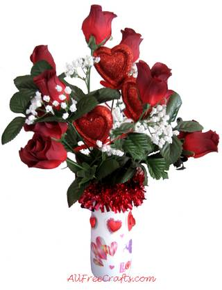 homemade valentine bouquet with silk roses in coffee creamer bottle