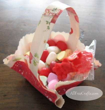 paper Valentine basket filled with goodies