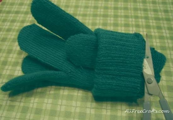 cutting open a knit glove