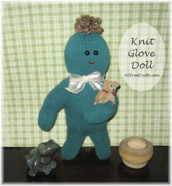 knit glove doll completed with hair, eyes and mouth