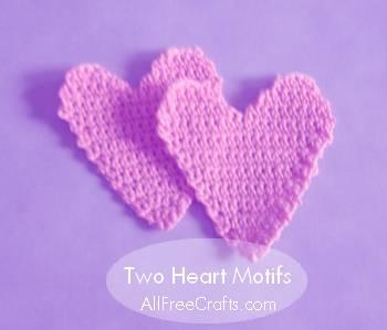 two crocheted heart motifs