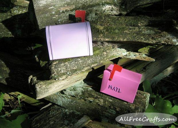 fairy mail boxes on a cedar fence
