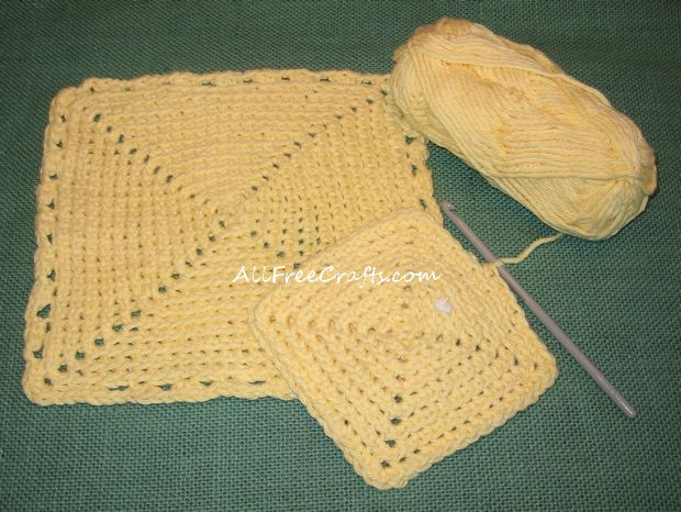 one completed single crochet dishcloth and another one started