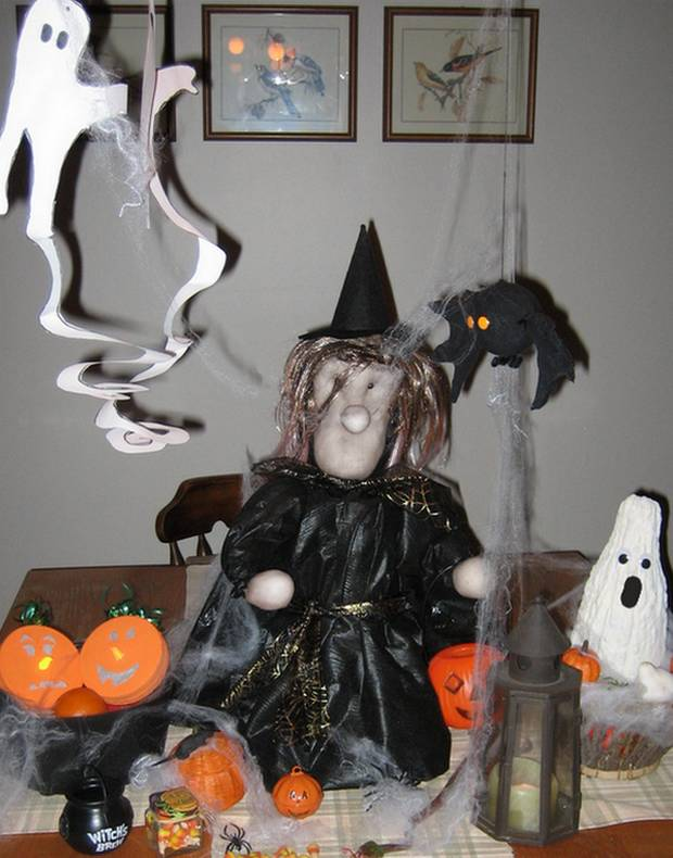soft sculpture witch with paper ghosts and reyccled Halloween decorations
