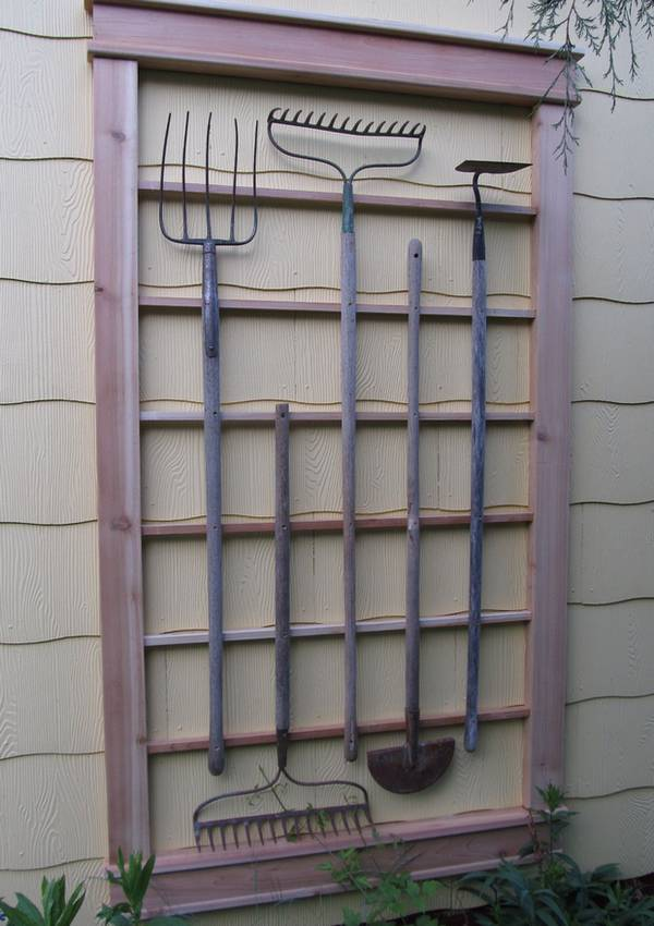 repurposed garden tools trellis