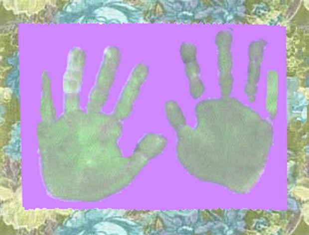 hand prints framed by wallpaper