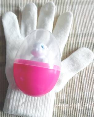knit glove and plastic treat Easter egg
