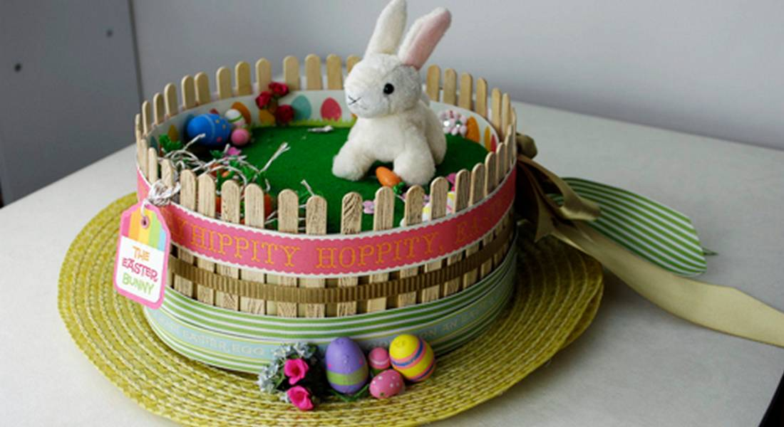 straw hat Easter bonnet with bunny and carrots