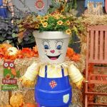 clay pot scarecrow with flowers