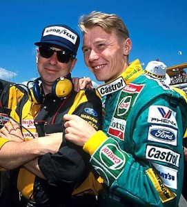 Mika Hakkinen (FIN) (right) shares a joke with his Lotus mechanics in his final GP with the team. Australian Grand Prix, Adelaide, 8 November 1992.
