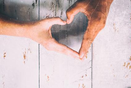 hands in shape of love heart