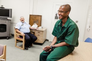 Sheldon Johnson laughs with the Corrections Officer after our interview as we talked politics.