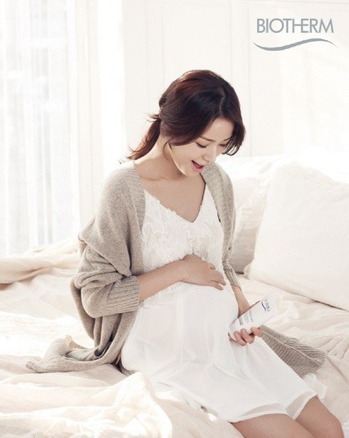 Son Tae Young shows off her baby bump for Biotherm  allkpop