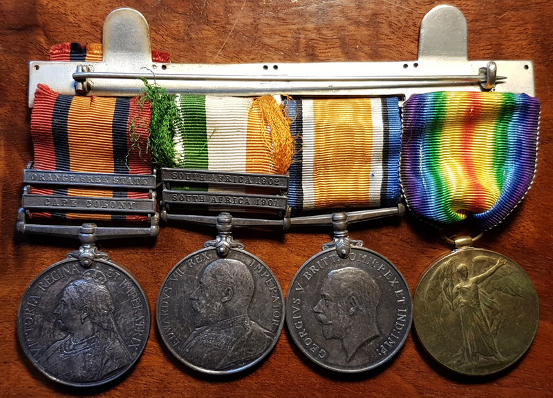 4 medals with obverse heads side showing