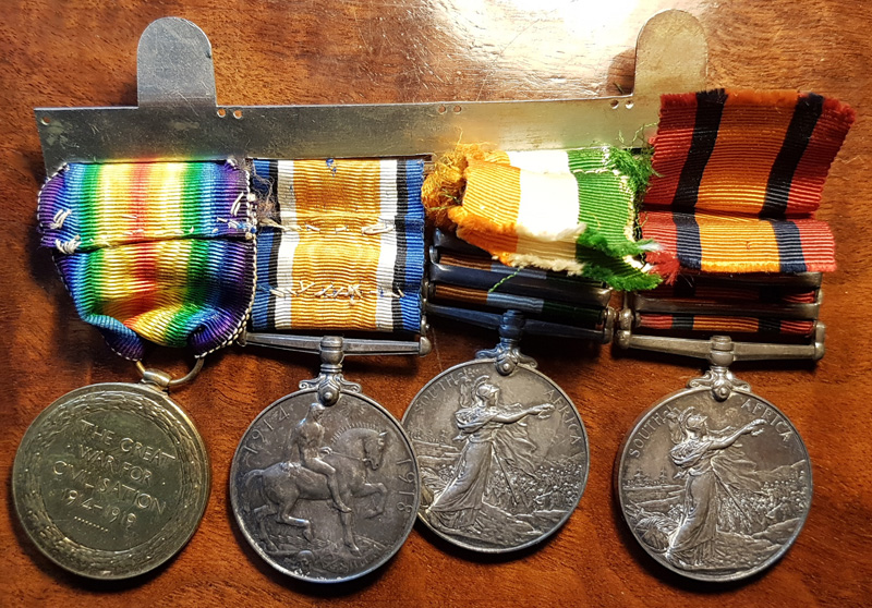 4 medals with reverse side showing