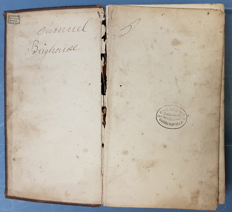 Bible open , signed 'Samuel Brighouse'