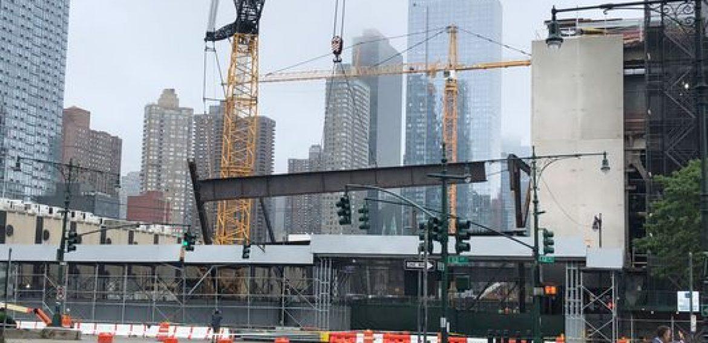 Crane drops steel beams at NYC construction site