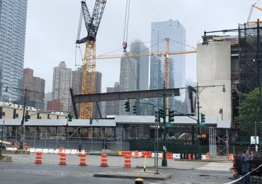Crane drops steel beams at NYC construction site