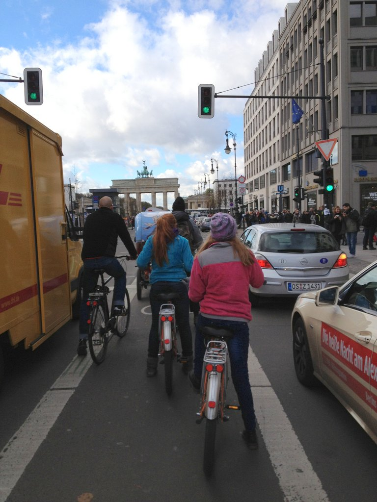 John and the girls on their Fat Tire bikes heading for the Brandenburg Gate.
