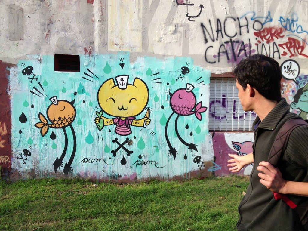 Female Buenos Aires street artist Pum Pum paints cute creatures with long legs.