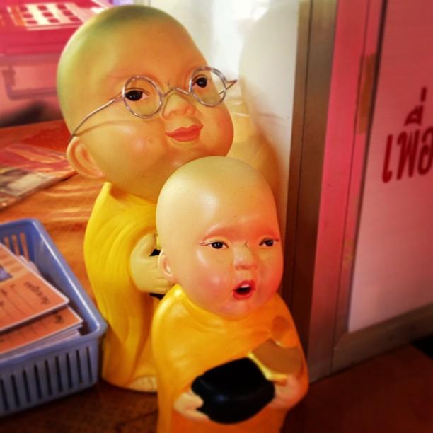 Little buddhist monk dolls in a Thai temple.