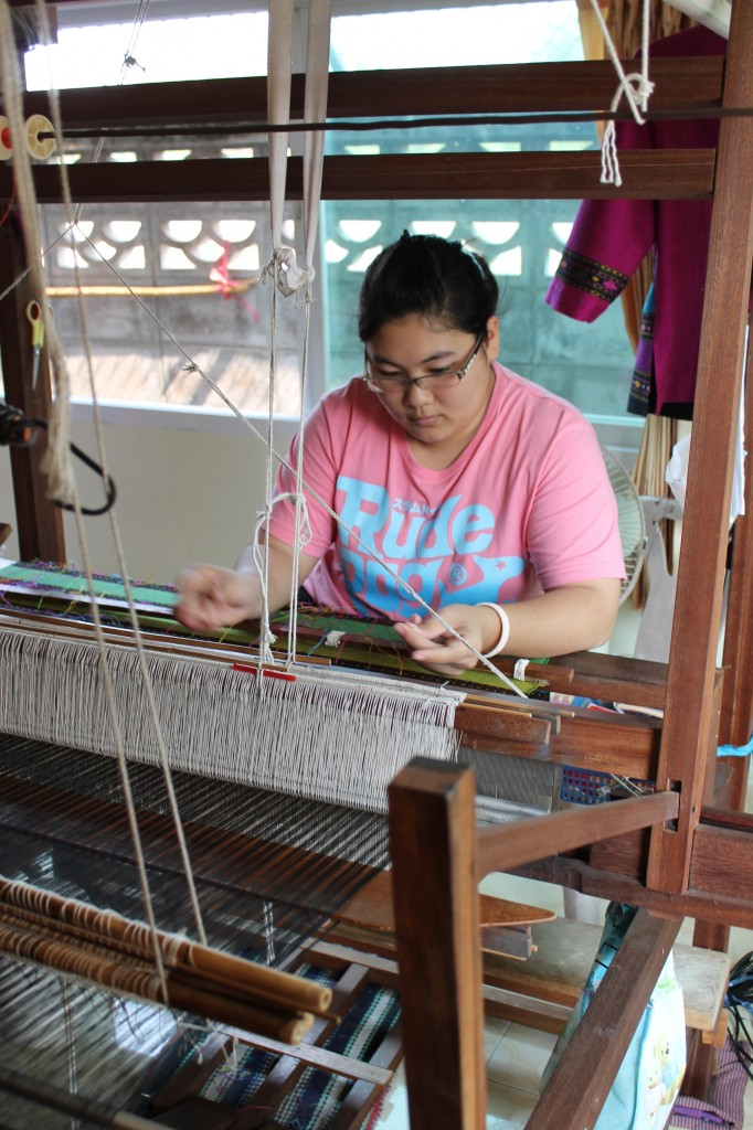 a weaver of chok fabric in Thailand