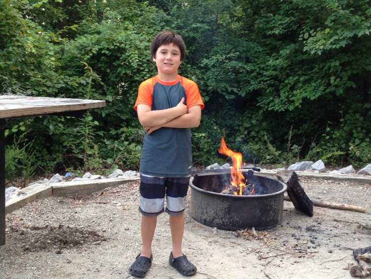 J built a fire at camp.  Sweaty work and it was rewarded by a swim in the lake.