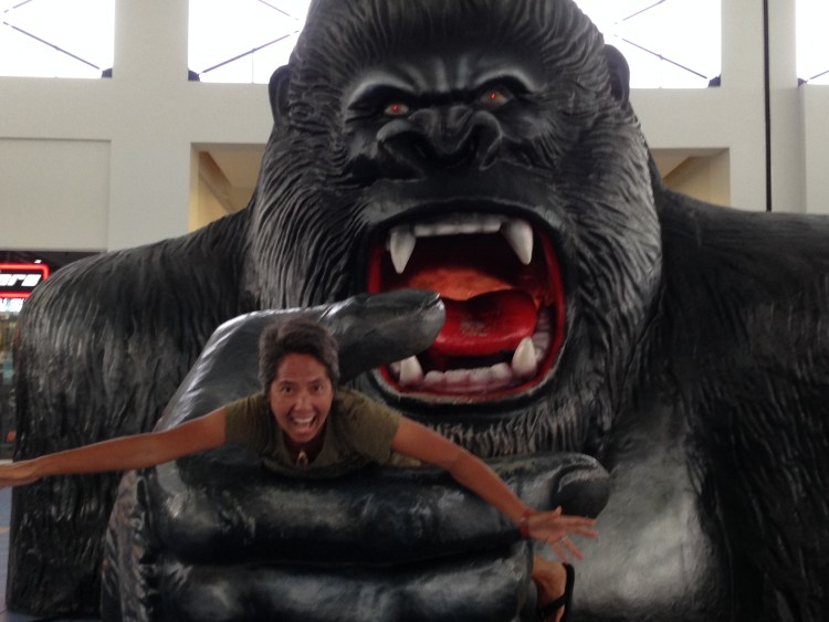 R clowning around with a big monkey at the mall in Panama City.