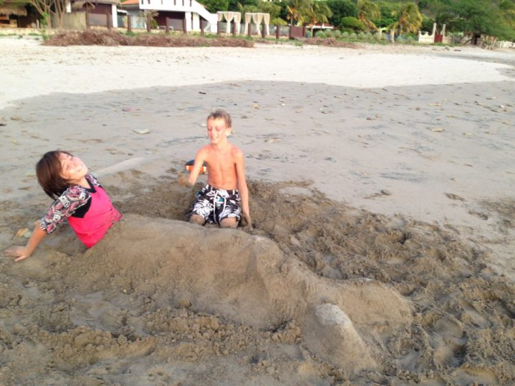 J and Owen clowning around on Playa Marsella.