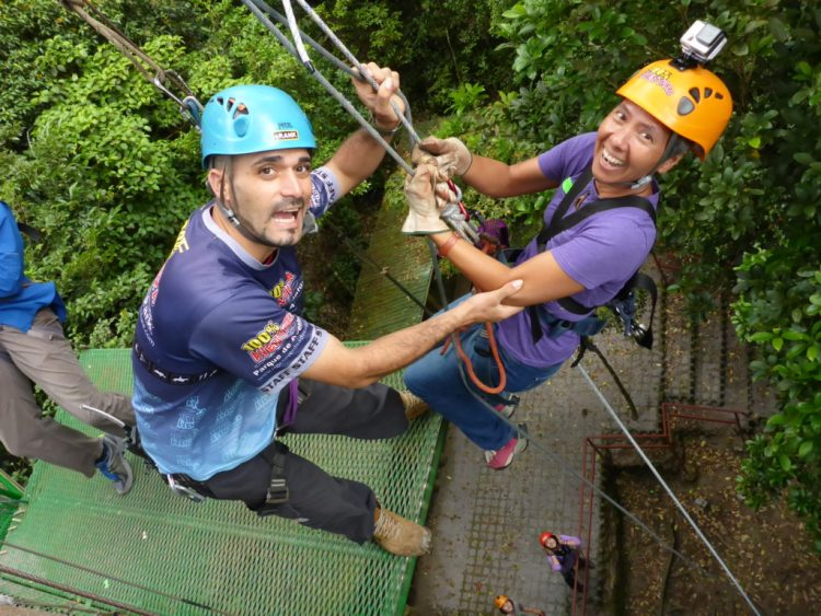 R about to rappel to the ground as part of our multi-faceted adventure package at 100% Aventura