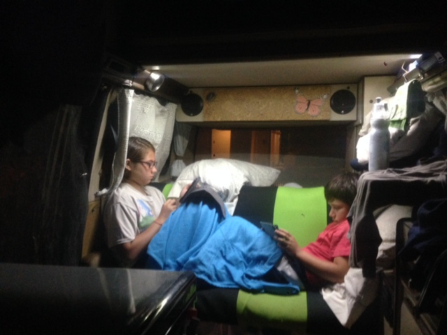 Coconut and J relax before bed time with their screens - the scourge of the 21st century parent.