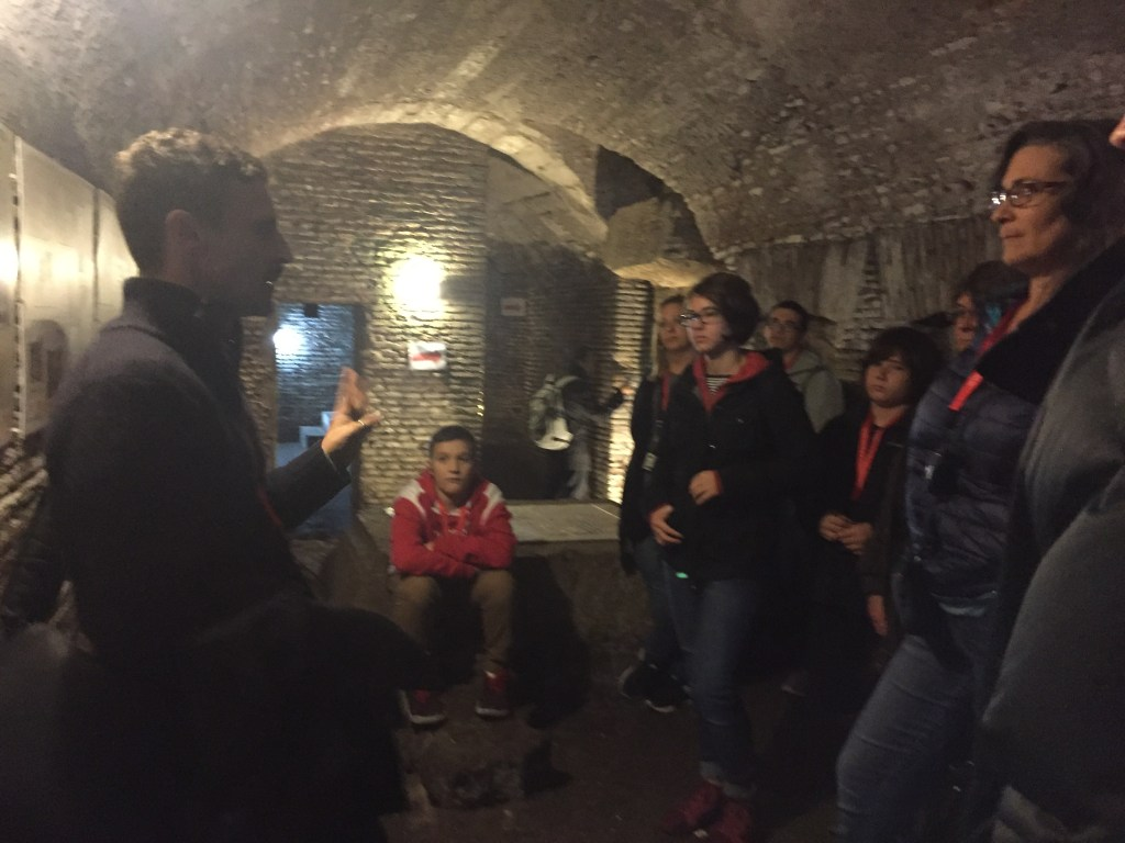 In the crypt on a catacombs tour with kids