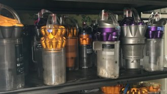 Dyson vacuum parts on shelf, cyclone, bin, prefilter