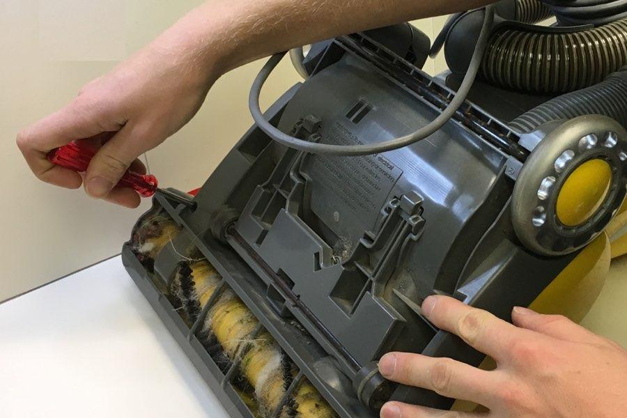 More Than Vacuums tech repairing a vacuum
