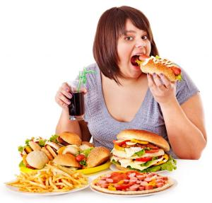 2-Overweight-woman-eating-fast-food-it-is-the-worst-food_zpsdad22d35