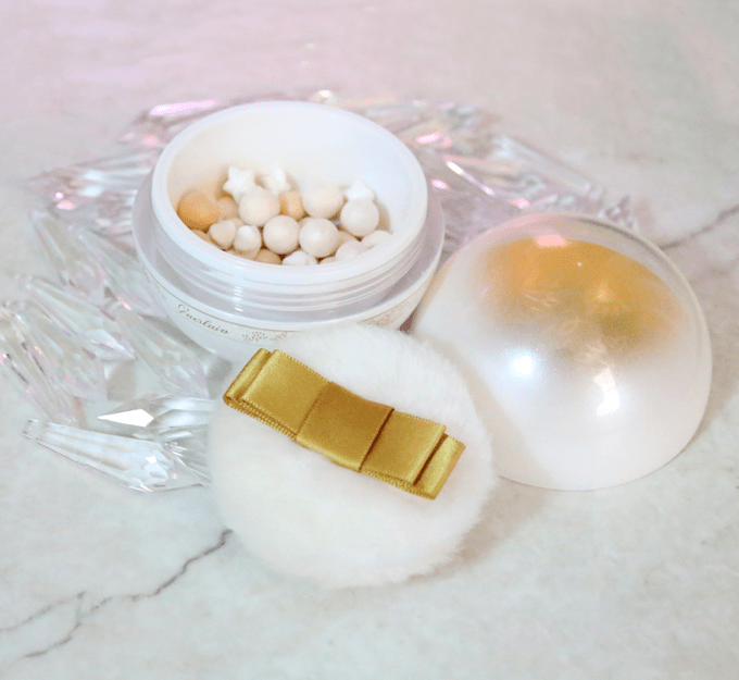 Review & demo of the coveted Winter Fairy Tale Guerlain Météorites Pearls Powder For The Face & Décolleté on All Things Beautiful XO. This gorgeous packaging resembles a snow globe with white & gold touches. Luxurious & an absolute must-have for the holiday season!