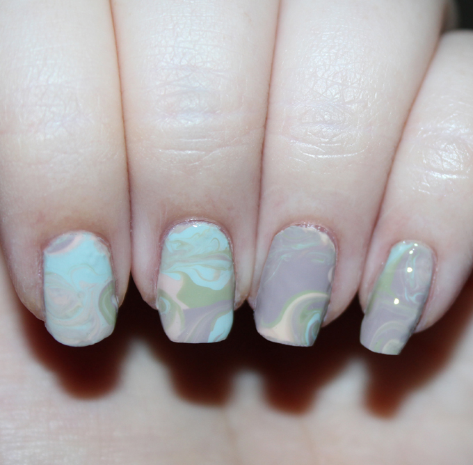 A DIY Easy Dry Water Marble Nail Art Manicure using the Zoya Whispers Collection including the shades April, Cala, Lake, Eastyn, Ireland, & Misty on All Things Beautiful XO